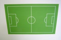 Fussballfeld an der Wand